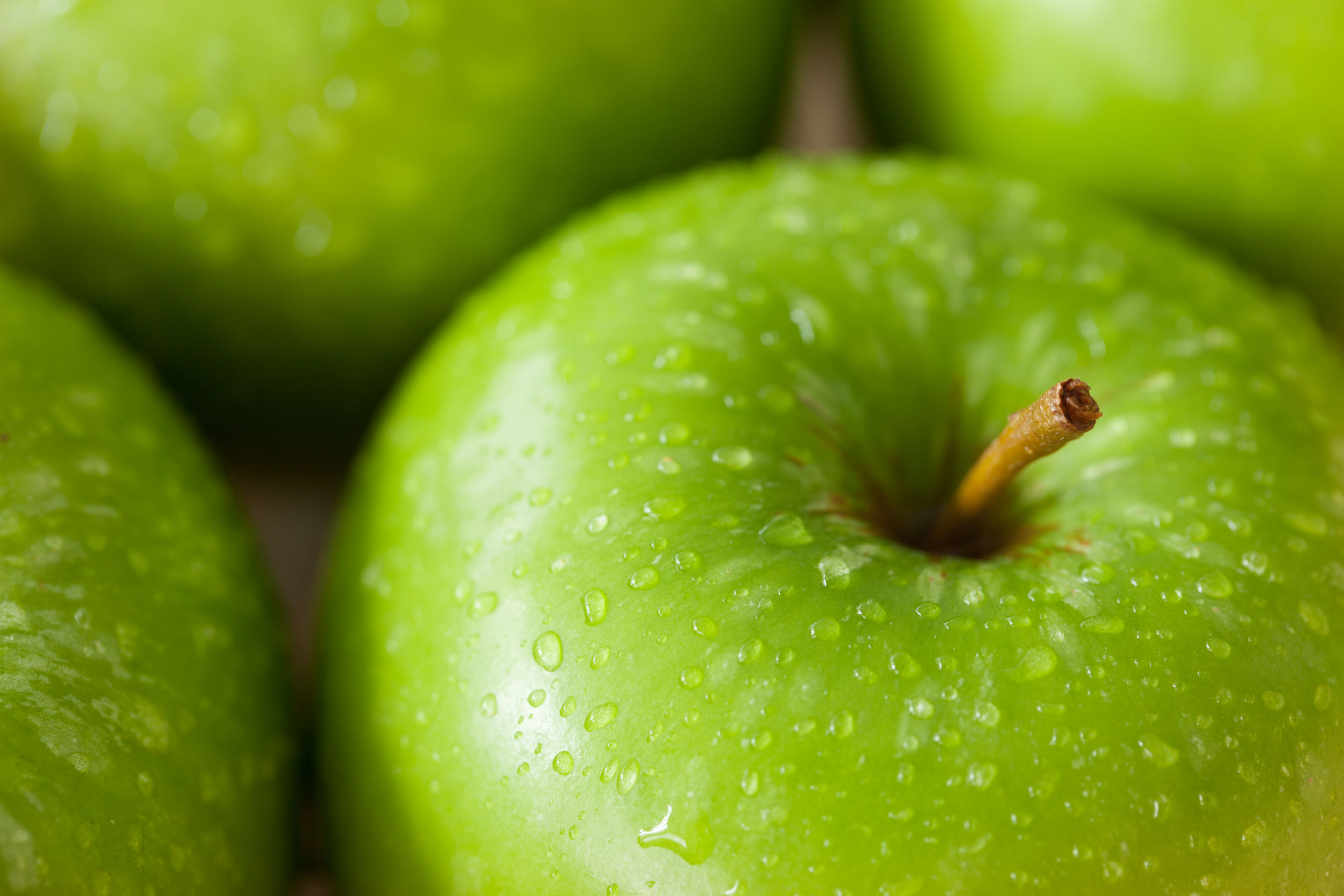 43624345 - green apple with water drop close up